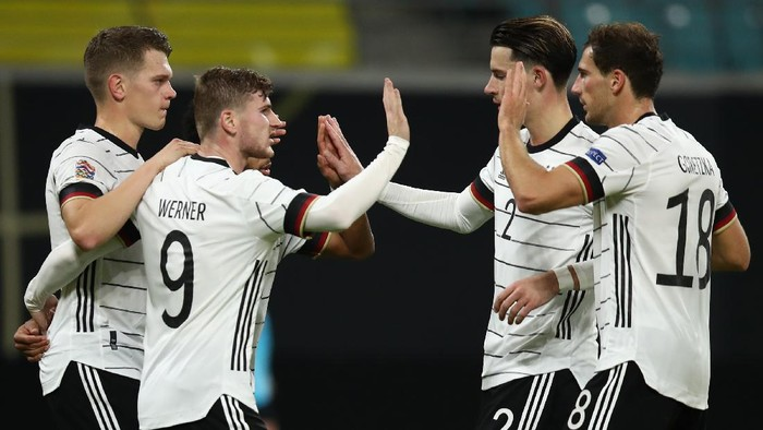 LEIPZIG, GERMANY - NOVEMBER 14: Timo Werner #9 of Germany celebrates his teams third goal with teammates  during the UEFA Nations League group stage match between Germany and Ukraine at Red Bull Arena on November 14, 2020 in Leipzig, Germany. (Photo by Maja Hitij/Getty Images)