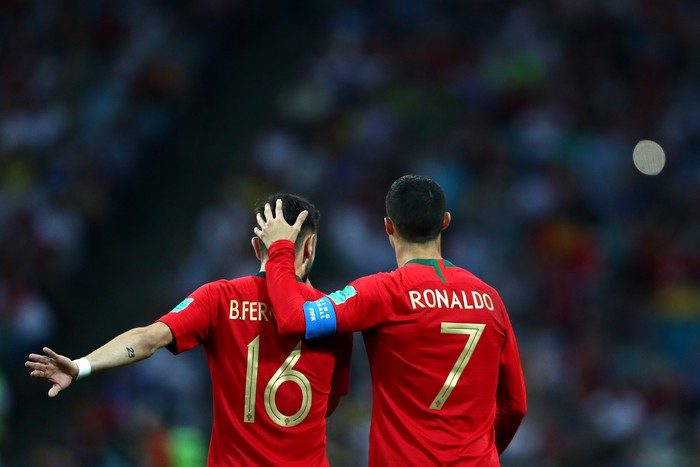 SOCHI, RUSSIA - JUNE 15:  Cristiano Ronaldo of Portugal embraces team mate Bruno Fernandes  during the 2018 FIFA World Cup Russia group B match between Portugal and Spain at Fisht Stadium on June 15, 2018 in Sochi, Russia.  (Photo by Dean Mouhtaropoulos/Getty Images)