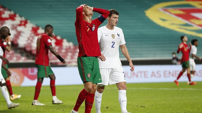 Portugals Cristiano Ronaldo reacts during the UEFA Nations League soccer match between Portugal and France at the Luz stadium in Lisbon, Saturday, Nov. 14, 2020. (AP Photo/Armando Franca)