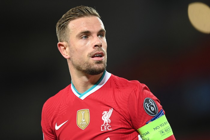LIVERPOOL, ENGLAND - OCTOBER 27: Jordan Henderson of Liverpool in action during the UEFA Champions League Group D stage match between Liverpool FC and FC Midtjylland at Anfield on October 27, 2020 in Liverpool, England. Sporting stadiums around the UK remain under strict restrictions due to the Coronavirus Pandemic as Government social distancing laws prohibit fans inside venues resulting in games being played behind closed doors. (Photo by Michael Regan/Getty Images)