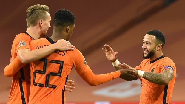 Netherlands' Luuk de Jong, left, and Denzel Dumfries, second left, celebrate with Memphis Depay, right, who soccer his side's third goal during the UEFA Nations League soccer match between The Netherlands and Bosnia and Herzegovina at the Johan Cruyff ArenA in Amsterdam, Netherlands, Sunday, Nov. 15, 2020. (John Thys/Pool via AP)