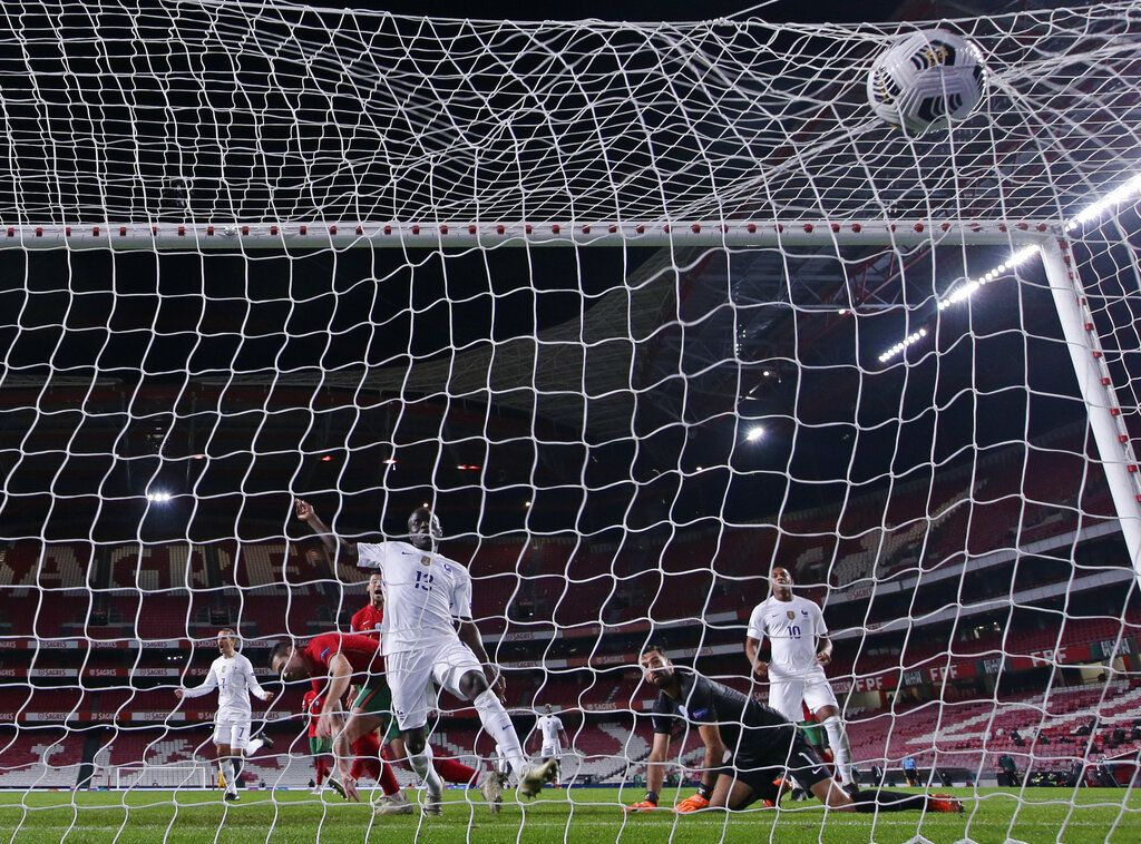 France's N???Golo Kante scores his side's opening goal during the UEFA Nations League soccer match between Portugal and France at the Luz stadium in Lisbon, Saturday, Nov. 14, 2020. (AP Photo/Armando Franca)