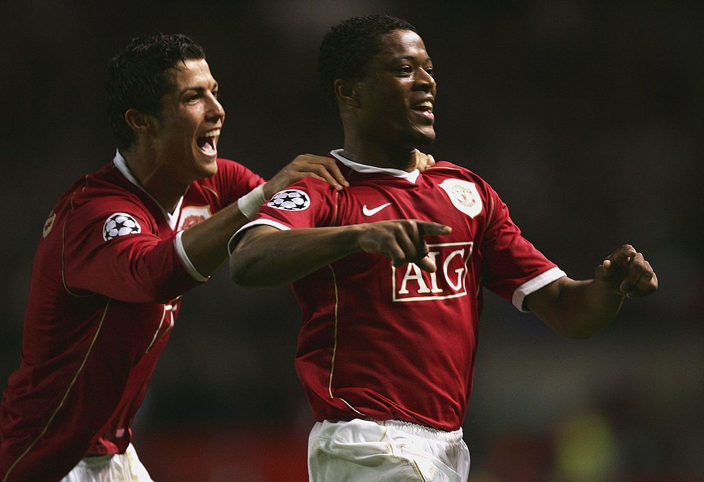 MANCHESTER, UNITED KINGDOM - APRIL 10: Patrice Evra of Manchester United celebrates scoring his team's seventh goal with team mate Cristiano Ronaldo during the UEFA Champions League Quarter Final, second leg match between Manchester United and AS Roma at Old Trafford on April 10, 2007 in Manchester, England. (Photo by Alex Livesey/Getty Images)