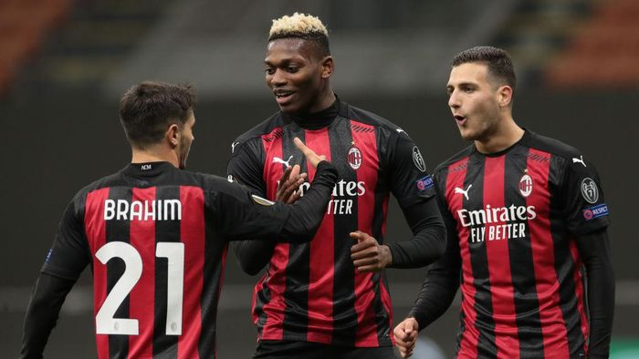 MILAN, ITALY - OCTOBER 29:  Rafael Leao (C) of AC Milan celebrates his goal with his team-mates Diogo Dalot (R) and Brahim Diaz during the UEFA Europa League Group H stage match between AC Milan and AC Sparta Praha at San Siro Stadium on October 29, 2020 in Milan, Italy. (Photo by Emilio Andreoli/Getty Images)