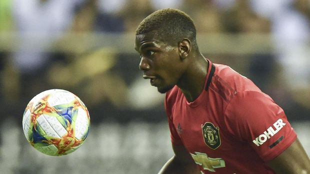 Manchester United's Paul Pogba with the ball during the International Champions Cup football tournament between English Premier League sides Manchester United and Tottenham at Hongkou Football Stadium in Shanghai on July 25, 2019. (Photo by HECTOR RETAMAL / AFP)