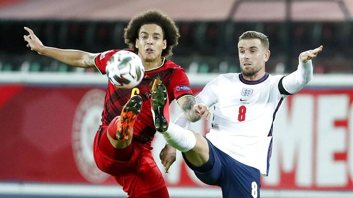 Belgiums Axel Witsel, left, and Englands Jordan Henderson battle for the ball during the UEFA Nations League soccer match between Belgium and England at the King Power stadium in Leuven, Belgium, Sunday, Nov. 15, 2020. (AP Photo/Francisco Seco)