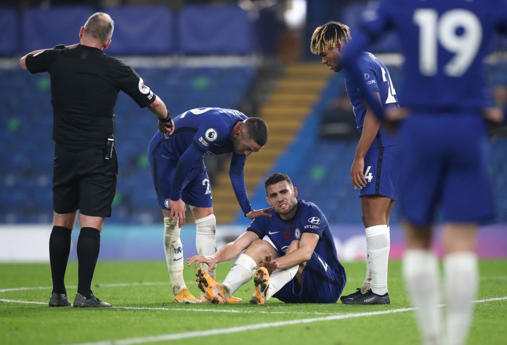 SOUTHAMPTON, ENGLAND - OCTOBER 25: Jannick Vestergaard of Southampton goes down injured during the Premier League match between Southampton and Everton at St Mary's Stadium on October 25, 2020 in Southampton, England. Sporting stadiums around the UK remain under strict restrictions due to the Coronavirus Pandemic as Government social distancing laws prohibit fans inside venues resulting in games being played behind closed doors. (Photo by Naomi Baker/Getty Images)