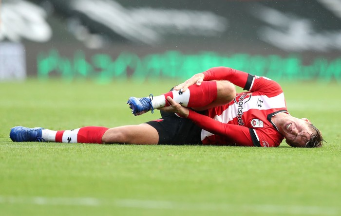 SOUTHAMPTON, ENGLAND - OCTOBER 25: Jannick Vestergaard of Southampton goes down injured during the Premier League match between Southampton and Everton at St Marys Stadium on October 25, 2020 in Southampton, England. Sporting stadiums around the UK remain under strict restrictions due to the Coronavirus Pandemic as Government social distancing laws prohibit fans inside venues resulting in games being played behind closed doors. (Photo by Naomi Baker/Getty Images)