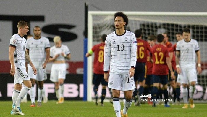Germanys midfielder Leroy Sane reacts to Spains fourth goal scored by Spains midfielder Ferran Torres during the UEFA Nations League footbal match between Spain and Germany at La Cartuja stadium in Seville on November 17, 2020. (Photo by CRISTINA QUICLER / AFP)