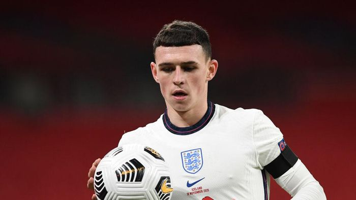 LONDON, ENGLAND - NOVEMBER 18: Phil Foden of England looks on during the UEFA Nations League group stage match between England and Iceland at Wembley Stadium on November 18, 2020 in London, England. Football Stadiums around Europe remain empty due to the Coronavirus Pandemic as Government social distancing laws prohibit fans inside venues resulting in fixtures being played behind closed doors. (Photo by Neil Hall - Pool/Getty Images)