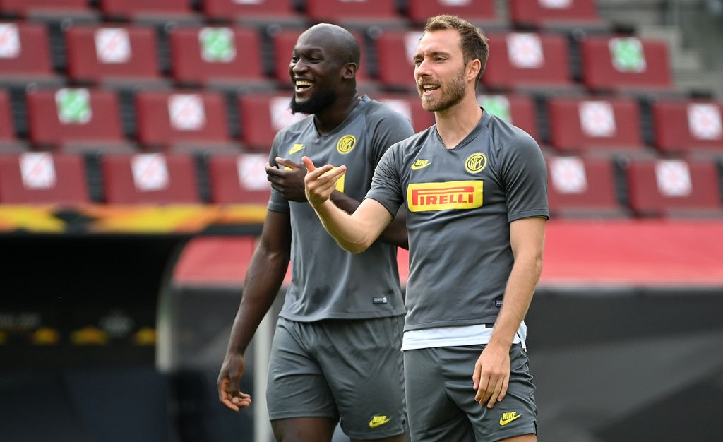 COLOGNE, GERMANY - AUGUST 20: Romelu Lukaku of Inter Milan and Christian Eriksen of Inter Milan react during a training session ahead of their UEFA Europa League match against Sevilla at RheinEnergieStadion on August 20, 2020 in Cologne, Germany. (Photo by Ina Fassbender/Pool via Getty Images)