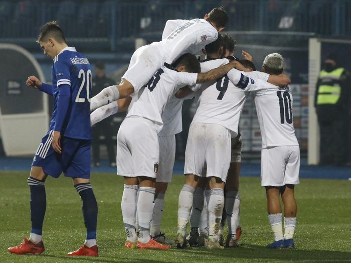 Italy players celebrate after Domenico Berardi scoried his sides second goal during the UEFA Nations League soccer match between Bosnia and Italy, in Sarajevo, Bosnia, Wednesday, Nov. 18, 2020. (AP Photo/Kemal Softic)