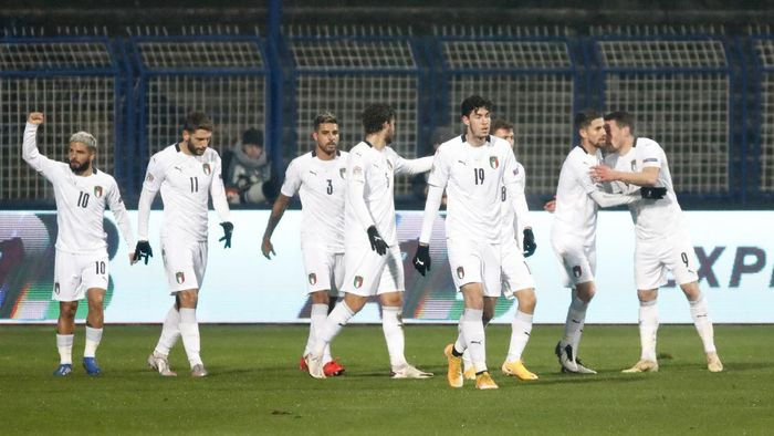 Italy players celebrate after Italys Andrea Belotti scored his sides opening goal during the UEFA Nations League soccer match between Bosnia and Italy, in Sarajevo, Bosnia, Wednesday, Nov. 18, 2020. (AP Photo/Kemal Softic)