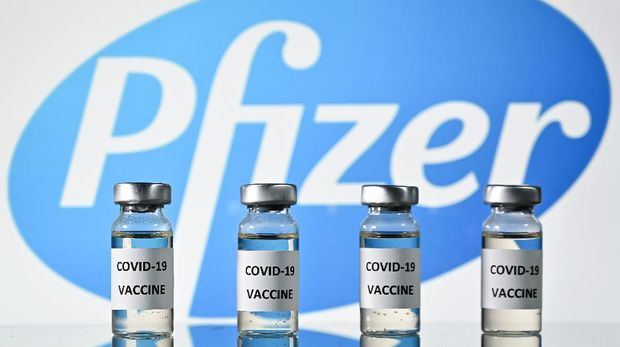 (FILES) This file photo illustration picture shows vials with Covid-19 Vaccine stickers attached, with the logo of US pharmaceutical company Pfizer, on November 17, 2020. - Pfizer and BioNTech said on November 18, 2020 a completed analysis of their experimental Covid-19 vaccine found it protected 95 percent of people against the disease and announced they were applying for US emergency approval