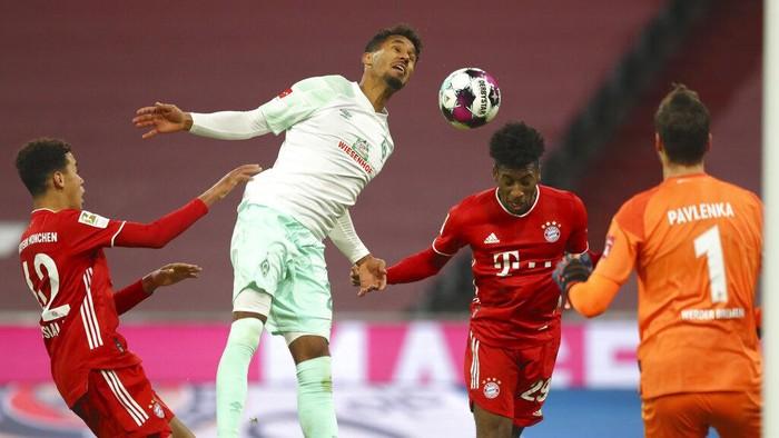 Bayerns Kingsley Coman, second right, scores his sides opening goal during the German Bundesliga soccer match between FC Bayern Munich and SV Werder Bremen in Munich, Germany, Saturday, Nov. 21, 2020. (AP Photo/Matthias Schrader)