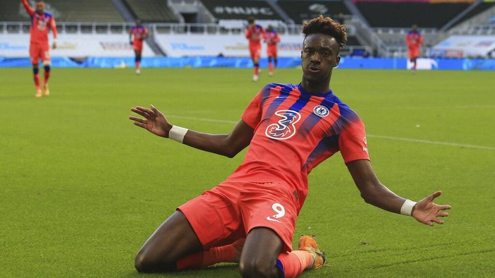 Chelseas Tammy Abraham celebrates after scoring his sides second goal during the English Premier League soccer match between Newcastle United v Chelsea at the St. James Park in Newcastle, England, Saturday, Nov. 21, 2020. (Lindsey Parnaby/ Pool via AP)