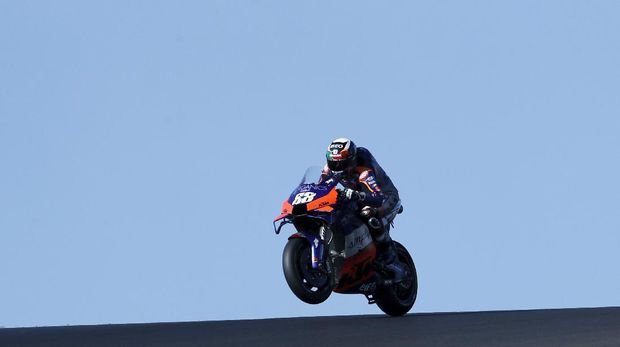 MotoGP rider Miguel Oliveira of Portugal steers his motorcycle during a free practice session for the Portuguese Motorcycle Grand Prix, the last race of the season, at the Algarve International circuit near Portimao, Portugal, Saturday, Nov. 21, 2020. The Portuguese Grand Prix will be held Sunday. (AP Photo/Armando Franca
