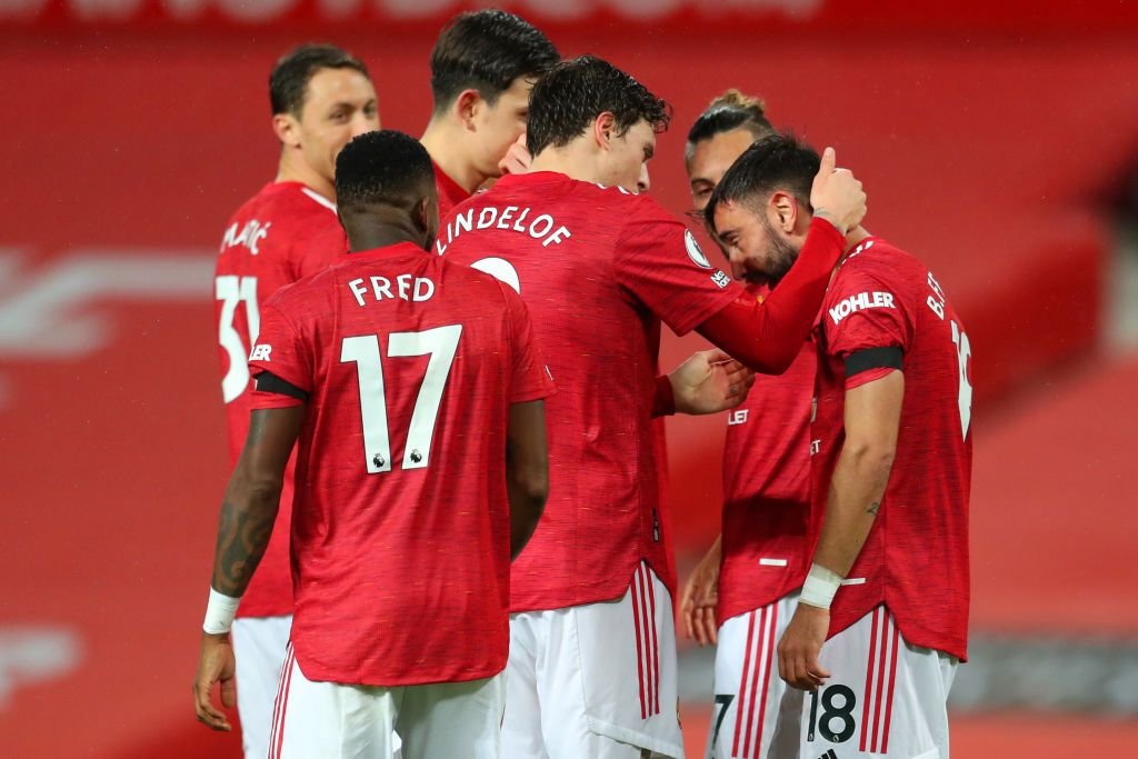 MANCHESTER, ENGLAND - NOVEMBER 21: Bruno Fernandes of Manchester United celebrates with teammate Victor Lindelof after scoring his team's first goal during the Premier League match between Manchester United and West Bromwich Albion at Old Trafford on November 21, 2020 in Manchester, England. Sporting stadiums around the UK remain under strict restrictions due to the Coronavirus Pandemic as Government social distancing laws prohibit fans inside venues resulting in games being played behind closed doors. (Photo by Catherine Ivill/Getty Images)