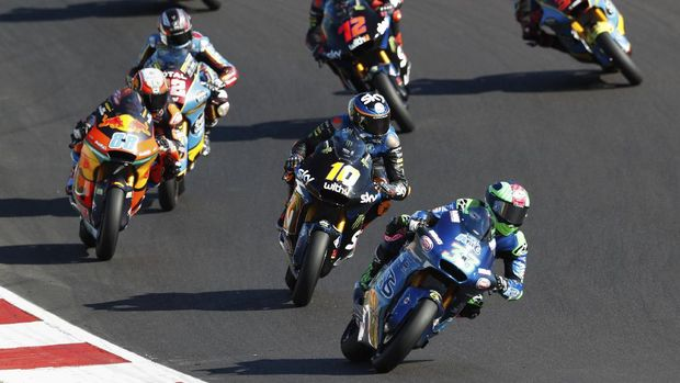Moto2 rider Enea Bastianini of Italy, competes ahead of Luca Marini of Italy and Jorge Martin of Spain, during the Moto 2 race of the Portuguese Motorcycle Grand Prix, the last race of the season, at the Algarve International circuit near Portimao, Portugal, Sunday, Nov. 22, 2020. (AP Photo/Armando Franca)
