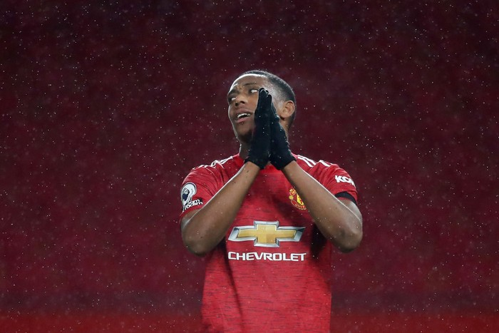MANCHESTER, ENGLAND - NOVEMBER 21: Anthony Martial of Manchester United reacts during the Premier League match between Manchester United and West Bromwich Albion at Old Trafford on November 21, 2020 in Manchester, England. Sporting stadiums around the UK remain under strict restrictions due to the Coronavirus Pandemic as Government social distancing laws prohibit fans inside venues resulting in games being played behind closed doors. (Photo by Martin Rickett - Pool/Getty Images)