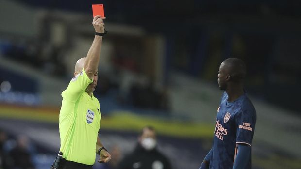 Arsenal's Nicolas Pepe is shown the read card by the referee during an English Premier League soccer match between Leeds United and Arsenal at Elland Road Stadium in Leeds, England, Sunday Nov. 22, 2020. (Molly Darlington/Pool Via AP)