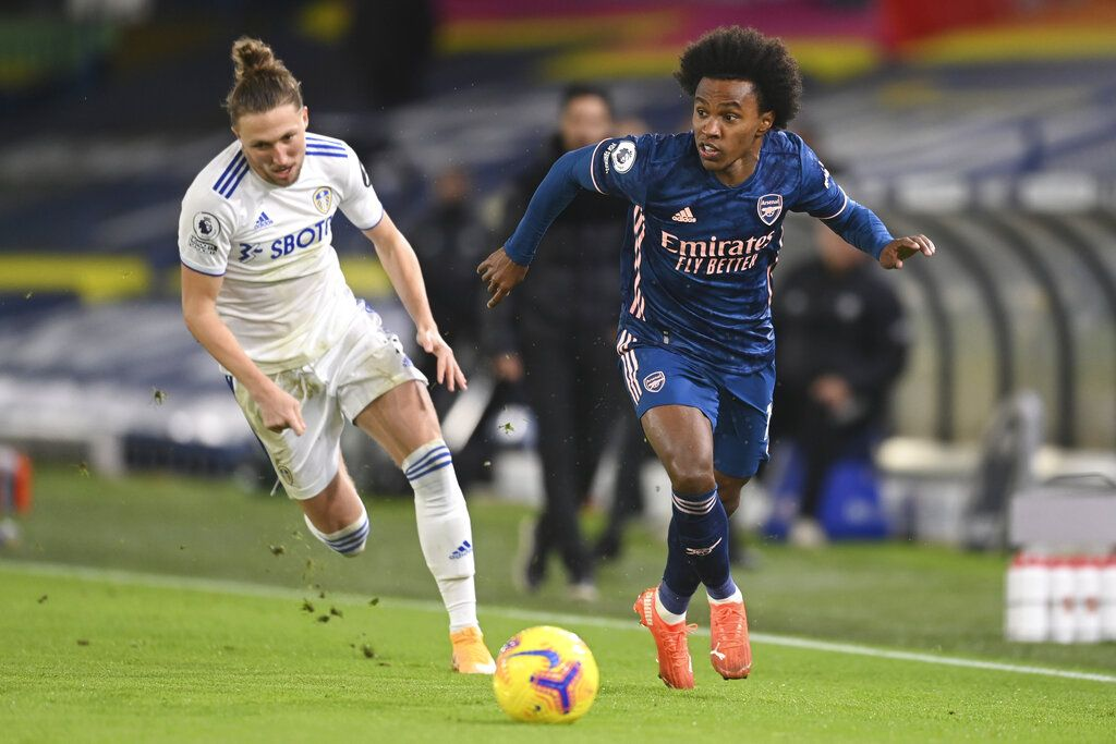 Arsenal's Willian, right, gets past Leeds United's Luke Ayling during an English Premier League soccer match between Leeds United and Arsenal at Elland Road Stadium in Leeds, England, Sunday Nov. 22, 2020. (Michael Regan/Pool Via AP)