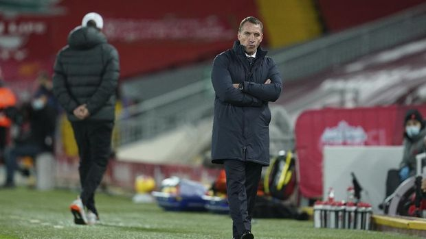 Leicester's manager Brendan Rodgers, right, and Liverpool's manager Jurgen Klopp walk during the English Premier League soccer match between Liverpool and Leicester City at Anfield stadium in Liverpool, England, Sunday, Nov. 22, 2020. (AP Photo/Jon Super)