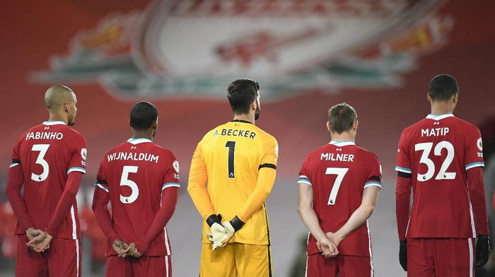 Liverpools team players attend a minute of silence in a memory of England goalkeeper Ray Clemence, who died on 15 November, before the English Premier League soccer match between Liverpool and Leicester City at Anfield stadium in Liverpool, England. Saturday, Nov. 22, 2020. (Peter Powell/Pool via AP)