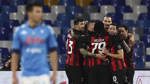 AC Milan's Zlatan Ibrahimovic, top center, celebrates scoring with teammates during the Serie A soccer match between Napoli and AC Milan, at the San Paolo Stadium in Naples, Italy, Sunday, Nov. 22, 2020. (Alessandro Garofalo/LaPresse via AP)