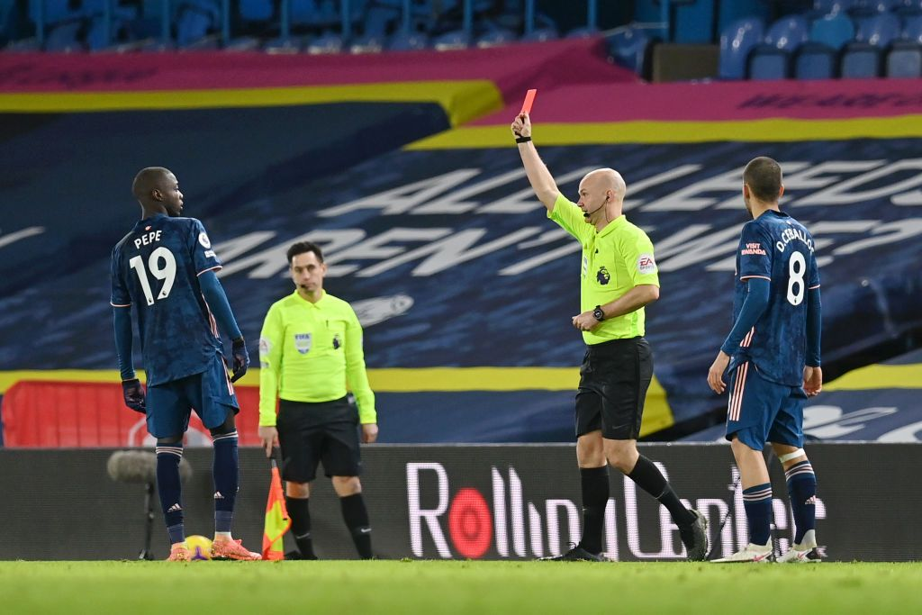 LEEDS, ENGLAND - NOVEMBER 22: Nicolas Pepe of Arsenal(R) is shown a red card by Match Referee Anthony Taylor(L) during the Premier League match between Leeds United and Arsenal at Elland Road on November 22, 2020 in Leeds, England. Sporting stadiums around the UK remain under strict restrictions due to the Coronavirus Pandemic as Government social distancing laws prohibit fans inside venues resulting in games being played behind closed doors. (Photo by Molly Darlington - Pool/Getty Images)