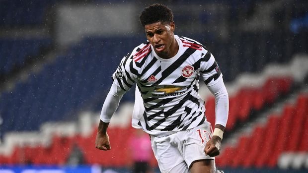 Manchester United's English Forward Marcus Rashford celebrates after scoring a goal  during the UEFA Champions League Group H first-leg football match between Paris Saint-Germain (PSG) and Manchester United at the Parc des Princes stadium in Paris on October 20, 2020. (Photo by FRANCK FIFE / AFP)