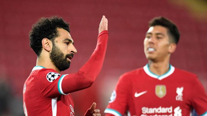 LIVERPOOL, ENGLAND - OCTOBER 27: Mohamed Salah of Liverpool  celebrates after he scores his teams second goal from the penalty spot during the UEFA Champions League Group D stage match between Liverpool FC and FC Midtjylland at Anfield on October 27, 2020 in Liverpool, England. Sporting stadiums around the UK remain under strict restrictions due to the Coronavirus Pandemic as Government social distancing laws prohibit fans inside venues resulting in games being played behind closed doors. (Photo by Peter Powell -