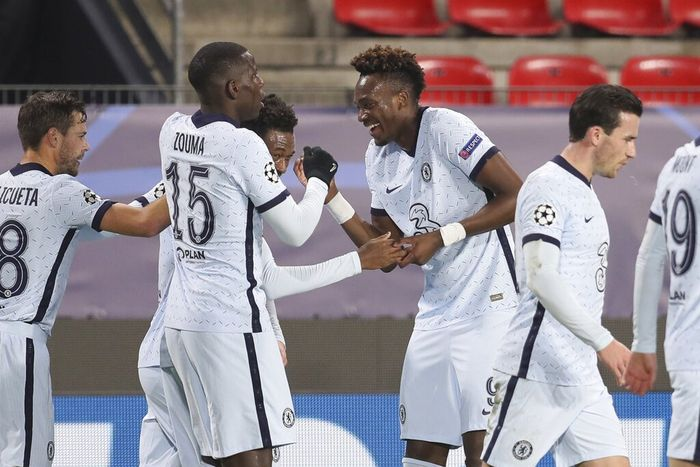 Chelsea players celebrate the opening goal of their team during the Champions League, group E soccer match between Rennes and Chelsea at the Roazhon Park stadium in Rennes, France, Tuesday, Nov. 24, 2020. (AP Photo/David Vincent)
