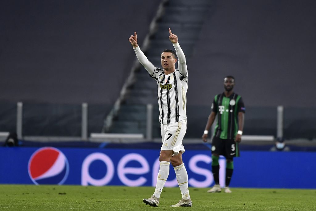 Juventus' Cristiano Ronaldo celebrates after scoring during the Champions league, group G soccer match between Juventus and Ferencvaros, at the Allianz Stadium in Turin, Italy, Tuesday, Nov. 24, 2020. (Marco Alpozzi/LaPresse via AP)