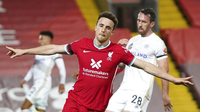 Liverpools Diogo Jota, center, celebrates after scoring his sides second goal during the English Premier League soccer match between Liverpool and Leicester City at Anfield stadium in Liverpool, England, Sunday, Nov. 22, 2020. (AP Photo/Jon Super)