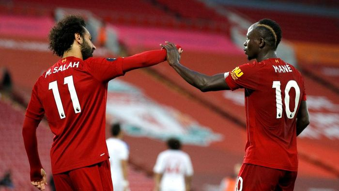 LIVERPOOL, ENGLAND - JUNE 24: Sadio Mane of Liverpool celebrates with Mohamed Salah of Liverpool after scoring his sides fourth goal during the Premier League match between Liverpool FC and Crystal Palace at Anfield on June 24, 2020 in Liverpool, England. (Phil Noble/Pool via Getty Images)