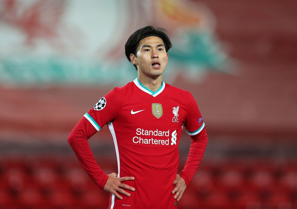LIVERPOOL, ENGLAND - OCTOBER 27: Takumi Minamino of Liverpool looks on during the UEFA Champions League Group D stage match between Liverpool FC and FC Midtjylland at Anfield on October 27, 2020 in Liverpool, England. Sporting stadiums around the UK remain under strict restrictions due to the Coronavirus Pandemic as Government social distancing laws prohibit fans inside venues resulting in games being played behind closed doors. (Photo by Peter Byrne -  Pool/Getty Images)