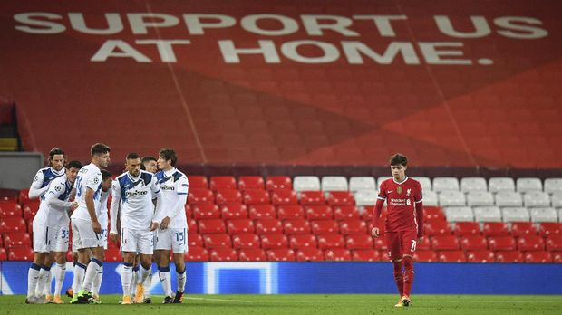 Atalanta's Josip Ilicic celebrates with teammates after scoring his side's opening goal during the Champions League group D soccer match between Liverpool and Atalanta at Anfield stadium in Liverpool, England, Wednesday, Nov. 25, 2020. (Paul Ellis/Pool via AP)