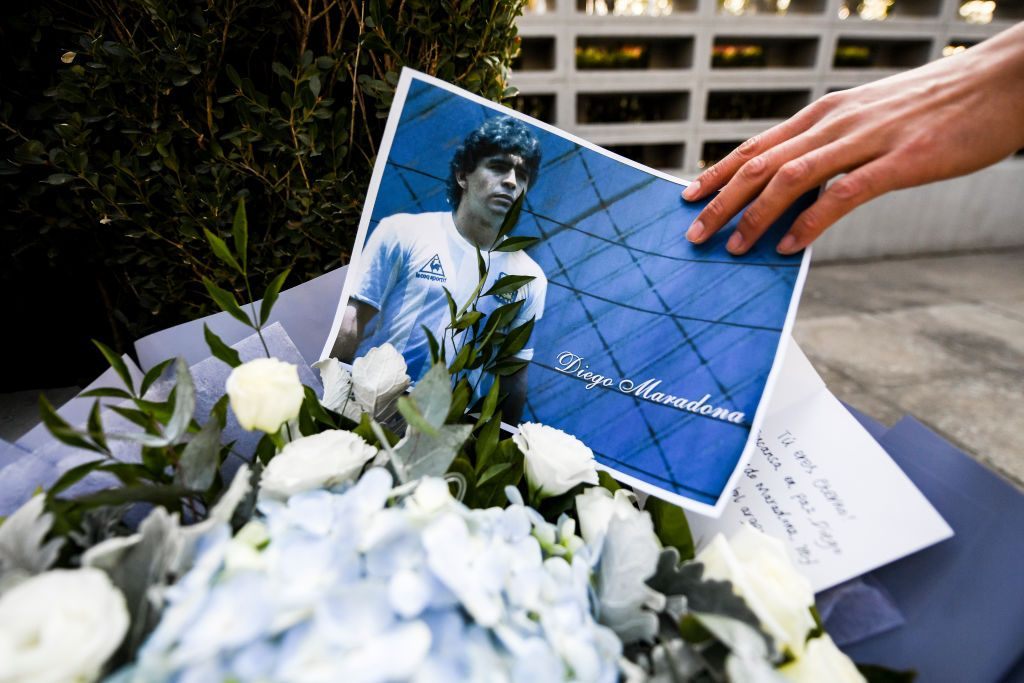 BEIJING, CHINA - NOVEMBER 26:  A staff arranged a photo in the Argentine Embassy for Mourning Diego Maradona on November 26, 2020 in Beijing, China.Diego Maradona, considered one of the biggest football stars in history, died at 60 from a heart attack on Wednesday in Buenos Aires.   (Photo by Di Yin/Getty Images)