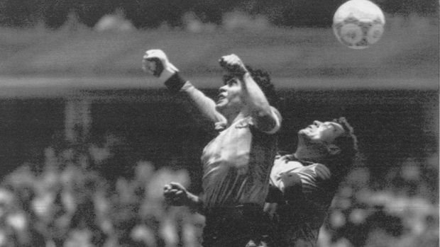 FILE - In this June 22, 1986 file photo, Argentina's Diego Maradona, left, beats England's goalkeeper Peter Shilton to a high ball and scores his first of two goals at the World Cup quarterfinal soccer match in Mexico City. On this day: This was the day of the
