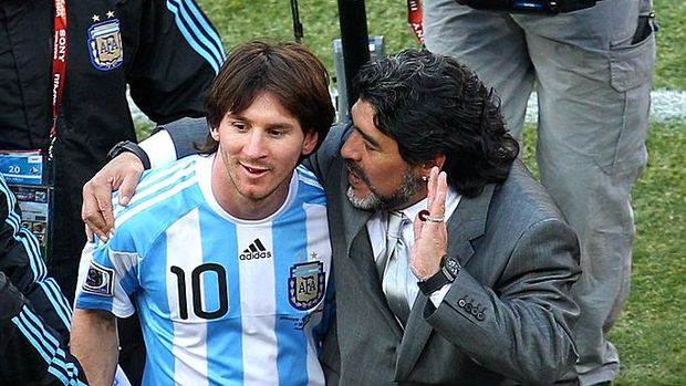 Argentine former football legend Diego Maradona (R) and Lionel Messi run during the friendly match