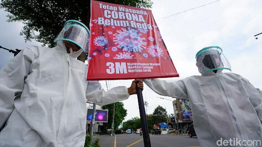 Foto Kampanye Prokes, Jangan Lengah! Corona Masih Ada