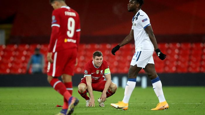 LIVERPOOL, ENGLAND - NOVEMBER 25: James Milner of Liverpool reacts to defeat after the UEFA Champions League Group D stage match between Liverpool FC and Atalanta BC at Anfield on November 25, 2020 in Liverpool, England. Sporting stadiums around the UK remain under strict restrictions due to the Coronavirus Pandemic as Government social distancing laws prohibit fans inside venues resulting in games being played behind closed doors. (Photo by Martin Rickett - Pool/Getty Images)