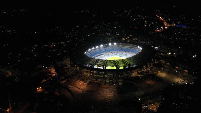 NAPLES, ITALY - NOVEMBER 25: The San Paolo stadium is lit as a tribute to the late soccer player Diego Armando Maradona on November 25, 2020 in Naples, Italy. Diego Armando Maradona died at 60 after a heart attack while he was at his house in Tigre, Argentina, where he was spending his convalescence after brain surgery three weeks before. (Photo by Ivan Romano/Getty Images)