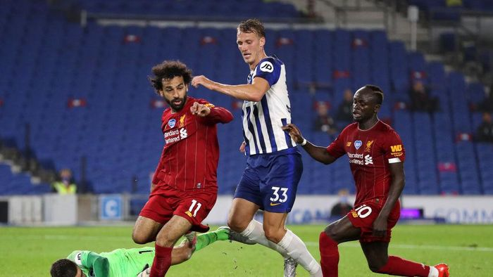 BRIGHTON, ENGLAND - JULY 08: Matthew Ryan of Brighton and Hove Albion collides with Mohamed Salah of Liverpool , Dan Burn of Brighton and Hove Albion and Sadio Mane of Liverpool  during the Premier League match between Brighton & Hove Albion and Liverpool FC at American Express Community Stadium on July 08, 2020 in Brighton, England. Football Stadiums around Europe remain empty due to the Coronavirus Pandemic as Government social distancing laws prohibit fans inside venues resulting in all fixtures being played behind closed doors. (Photo by Catherine Ivill/Getty Images)