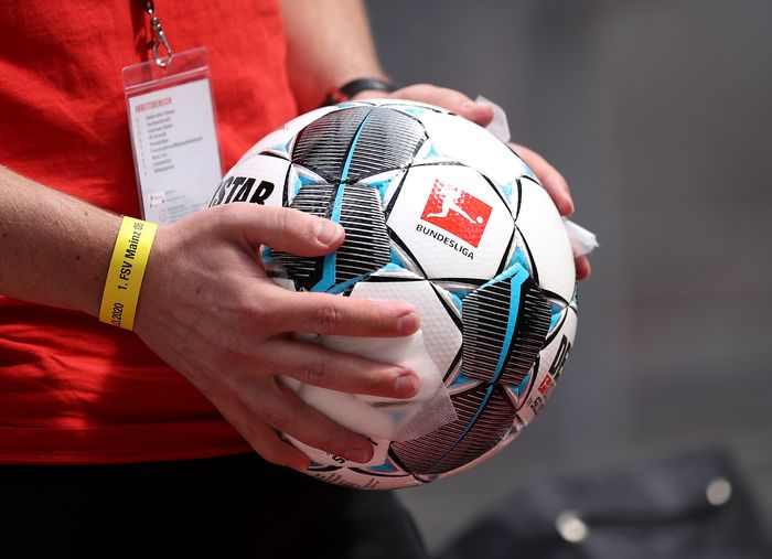COLOGNE, GERMANY - MAY 17: Ball boys disinfect the footballs ahead of the Bundesliga match between 1. FC Koeln and 1. FSV Mainz 05 at RheinEnergieStadion on May 17, 2020 in Cologne, Germany. The Bundesliga and Second Bundesliga is the first professional league to resume the season after the nationwide lockdown due to the ongoing Coronavirus (COVID-19) pandemic. All matches until the end of the season will be played behind closed doors. (Photo by Lars Baron/Getty Images)