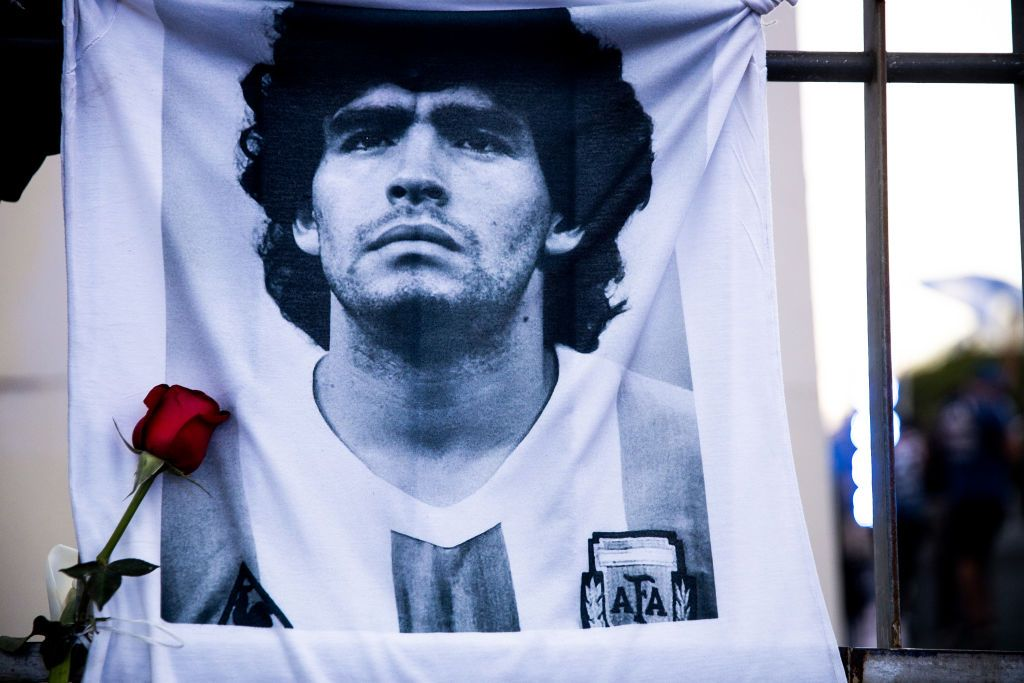 BUENOS AIRES, ARGENTINA - NOVEMBER 26: A shirt with the image of former football star Diego Maradona hangs on a fence on November 26, 2020 in Buenos Aires, Argentina. Diego Maradona, considered one of the biggest football stars in history, died at 60 from a heart attack on Wednesday in Buenos Aires.  (Photo by Tomas Cuesta/Getty Images)