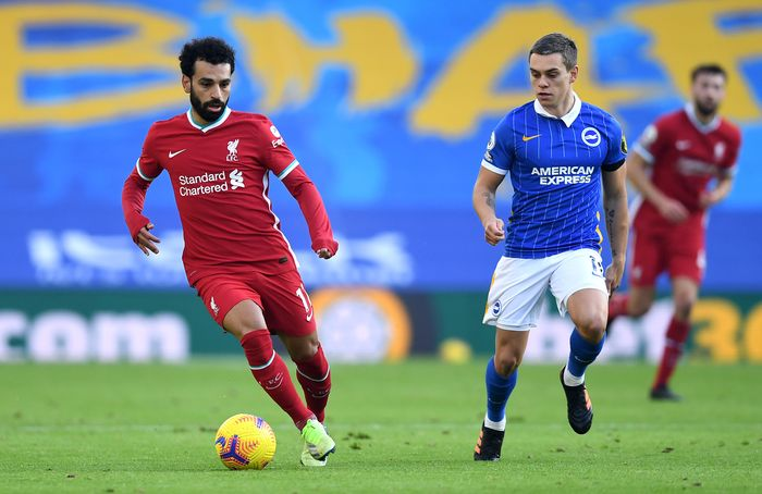BRIGHTON, ENGLAND - NOVEMBER 28: Mohamed Salah of Liverpool is closed down by Leondro Trossard of Brighton and Hove Albion during the Premier League match between Brighton & Hove Albion and Liverpool at American Express Community Stadium on November 28, 2020 in Brighton, England. Sporting stadiums around the UK remain under strict restrictions due to the Coronavirus Pandemic as Government social distancing laws prohibit fans inside venues resulting in games being played behind closed doors. (Photo by Neil Hall - Pool/Getty Images)