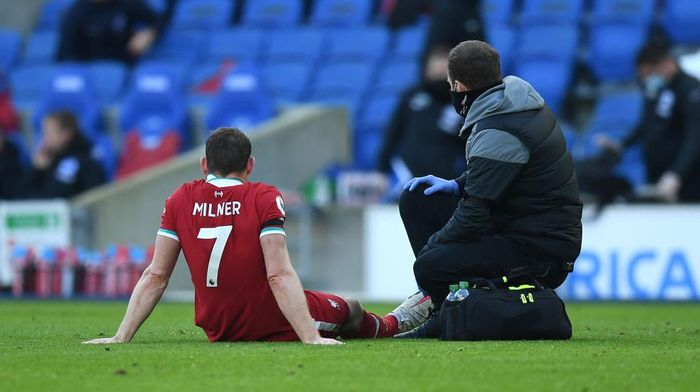 BRIGHTON, ENGLAND - NOVEMBER 28: James Milner of Liverpool receives medical treatment during the Premier League match between Brighton & Hove Albion and Liverpool at American Express Community Stadium on November 28, 2020 in Brighton, England. Sporting stadiums around the UK remain under strict restrictions due to the Coronavirus Pandemic as Government social distancing laws prohibit fans inside venues resulting in games being played behind closed doors. (Photo by Neil Hall - Pool/Getty Images)