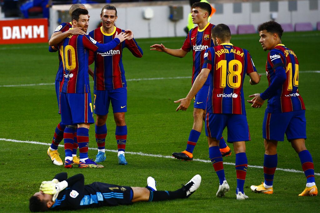 Barcelona's Martin Braithwaite, left, celebrates with his teammates after scoring his side's first goal during the Spanish La Liga soccer match between FC Barcelona and Osasuna at the Camp Nou stadium in Barcelona, Spain, Sunday, Nov. 29, 2020. (AP Photo/Joan Monfort)